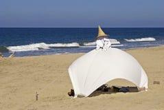 Sun tent on an ocean beach Stock Photography