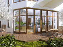The sun terrace of a private house. Boardwalk terrace with table and chairs. Large panoramic windows overlooking the garden with a terrace. 3D render Royalty Free Stock Images