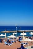 Sun Terrace and small harbour, Agios Nikolaos. Royalty Free Stock Images