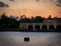 View of setting sun pm San Juan Harbor in Puerto Rico stock image