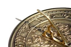 Sun Time. A brass sun dial with white background Royalty Free Stock Photos