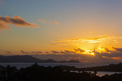 Sun about to appear above the clouds at sunset on St Thomas Island, US VI. Stock Photos