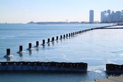 Sun about to set over Chicago skyline and a frozen Lake Michigan Royalty Free Stock Images
