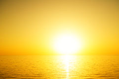 The sun to set over the sea horizon. The sun to set over the horizon reflected in the sea Royalty Free Stock Photography