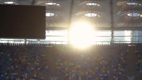 The sun to sit over the stadium panorama stock video footage