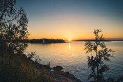 Sunset by Big Tub Lighthouse, Tobermory, Ontario. The sun touches the horizon at sunset by Big Tub Lighthouse in Tobermory, Ontario royalty free stock images