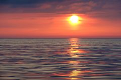 Sun track on the calm sea. At sunset royalty free stock image