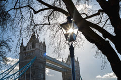 Sun trapped in a street lamp at Tower Bridge Royalty Free Stock Photos
