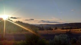 Sun resting on Central Oregon Butte stock photos