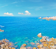 Sun and turquoise sea Stock Photography