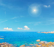 Sun and turquoise sea Stock Image