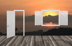 Sun at twilight behind the opening door and window,3D Stock Image