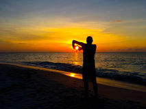 Sun in two hands. This is a moment during a sunset meditation stock photo