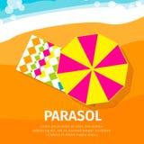 Sun umbrella – seasons parasol with beach towel. Royalty Free Stock Photo