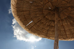 Sun umbrella. Reed sun umbrella with blue sky background Royalty Free Stock Photo
