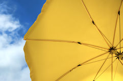 Sun umbrella. Shot taken under a yellow umbrella against the perfect blue sky Royalty Free Stock Images