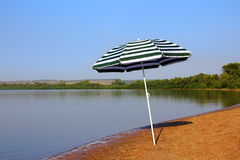 Sun umbrella on beach Stock Photography