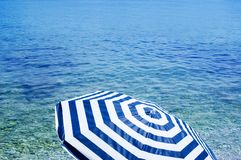 Sun umbrella on beach Royalty Free Stock Photography