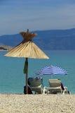 Sun umbrella and beach chair Stock Photos