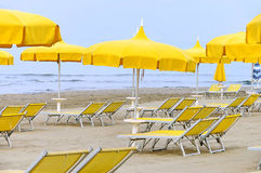 Sun umbrella and beach chair Stock Images