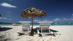 Sun umbrella and beach chairs on coastline with white sand. Boracay. Philippines stock video
