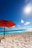 Sun and umbrella on the beach Stock Image
