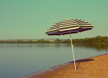Sun umbrella on beach - vintage retro style Royalty Free Stock Image