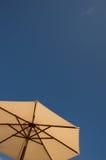 Sun umbrella and blue sky Royalty Free Stock Photography