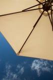 Sun umbrella and blue sky Stock Images