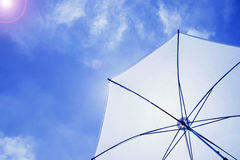 Sun umbrella in blue sky Royalty Free Stock Images