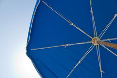 Sun umbrella on a bright, sunny day Royalty Free Stock Images