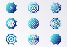 Sun umbrella icons. Blue gradient sun umbrella icons collection isolated Royalty Free Stock Photo