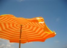 Sun umbrella in orange Stock Images