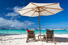 Sun umbrella with Santa Claus Hat on chairs Stock Photo