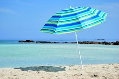 Sun Umbrella and Sea Stock Photos