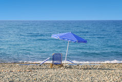 Sun umbrella and sunbeds Stock Images
