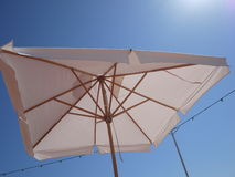Sun umbrella to protect because of bright sun Royalty Free Stock Photos