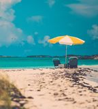 Sun umbrella on a tropical beach.  Royalty Free Stock Images