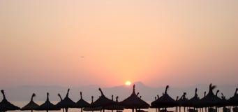 Sun umbrellas. Detail of sun umbrellas in sunset, Palma de Mallorca, Spain Royalty Free Stock Images