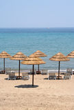 Sun Umbrellas. Thatched sun shades on a deserted beach on Zante (Zakynthos Stock Images