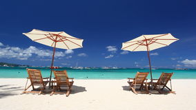 Sun umbrellas and beach chairs on coastline with white sand stock video footage