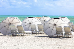 Sun umbrellas on the beach of ocean. Miami Beach Stock Image