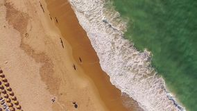 Sun umbrellas on the beach from the top aerial view. Sun umbrellas on the beach from the top stock footage