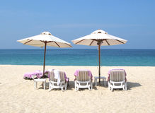 Sun umbrellas and chairs. Phuket island Stock Photography