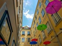 Sun umbrellas in the city. Low-angle shot of sun umbrellas in vivid colors in the city against a blue sky. Summer season. Vienna 2018 stock image