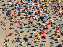 Sun umbrellas on a crowded beach Stock Photography