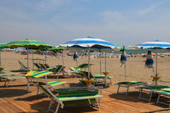 Sun umbrellas and deck chairs on the beach resort Royalty Free Stock Images