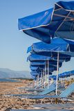 Sun umbrellas and loungers on the beach Royalty Free Stock Images