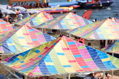 Sun umbrellas. Multicolored umbrellas on the beach near the sea. Sudak. Crimea Stock Image