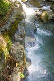 Sun una inmersión rápida en las montañas Imagen de archivo